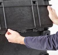 close up of a man opening the front lid of a explorer 5140 tool case