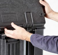 close up of a man opening the top lid of a explorer 5140 tool case