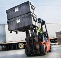 Peli 0550 transport cases being moved by an orange forklift