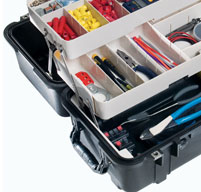 close up of an open peli 1460tool case with the trays full of tools