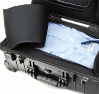 a close up of a Peli 1510LOC Laptop Overnight Cases storage compartment with a blue shirt inside
