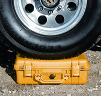 close up of peli 1610 case under a wheel of a vehicle