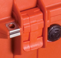 close up of an orange peli 1460ems cases double throw latches