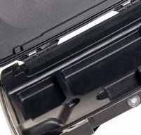 Close up of black i1075 case with accessory storage for power cords and earbuds stow below keyboard