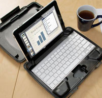 black i1075 hardback ipad case on a wooden table next to a coffee cup