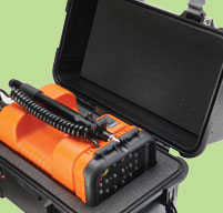 close up of an open peli 1460 case with an orange measuring equipment inside